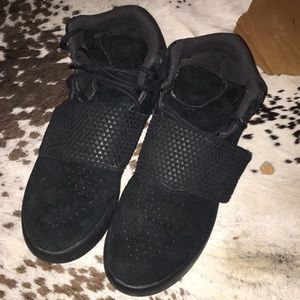 Kids black on black tubular hi top Adidas sneakers